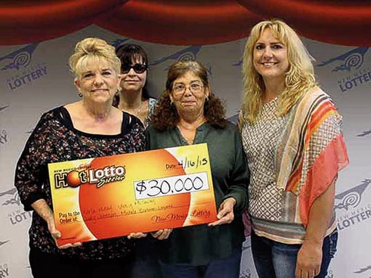 Four Grant County co-workers, Karla McKay of Santa Clara, Michele Blackman-Legarda of Arenas Valley, Vicky McCauley of Silver City, and Judy Johnson of Hanover, won 30,000 on April 16 on a lottery ticket purchased in Silver City. Courtesy Photo