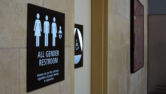 "An April 16, 2016, file photo shows an ""All Gender"" bathroom sign at the San Diego International Airport. The Obama administration plans to direct public schools to allow transgender students use whichever bathroom they prefer to match their gender identity."