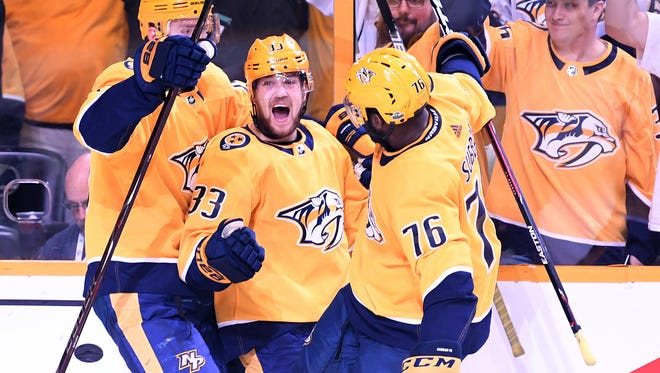 Apr 14, 2018; Nashville, TN, USA; Nashville Predators left wing Viktor Arvidsson (33) celebrates with defenseman Mattias Ekholm (14) and defenseman P.K. Subban (76) after a goal during the second period against the Colorado Avalanche in game two of the first round of the 2018 Stanley Cup Playoffs at Bridgestone Arena. Mandatory Credit: Christopher Hanewinckel-USA TODAY Sports