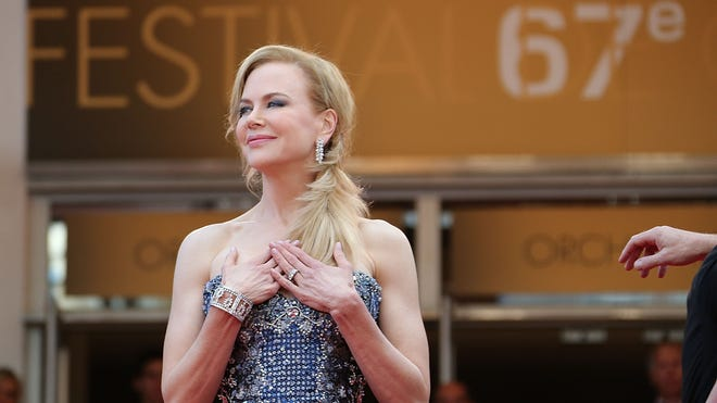 "Nicole Kidman poses as she arrives for the opening ceremony and the screening of her film ""Grace of Monaco"" at the 67th edition of the Cannes Film Festival."