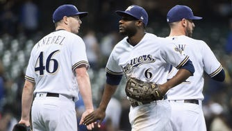 Closer Corey Knebel and centerfielder Lorenzo Cain celebrate the Brewers' 4-2 victory over the Diamondbacks on Monday night at Miller Park.