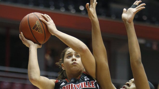 U of L guard Shoni Schimmel, shooting over Shelbi Chandler, was only 3 of 12 from the field but scored 10 points.