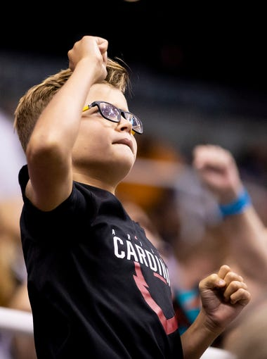 A young fan cheers during the playoff game between the Arizona Rattlers and the Sioux Falls Storm at Talking Stick Resort Arena on Saturday, June 23, 2018 in Phoenix, Arizona.