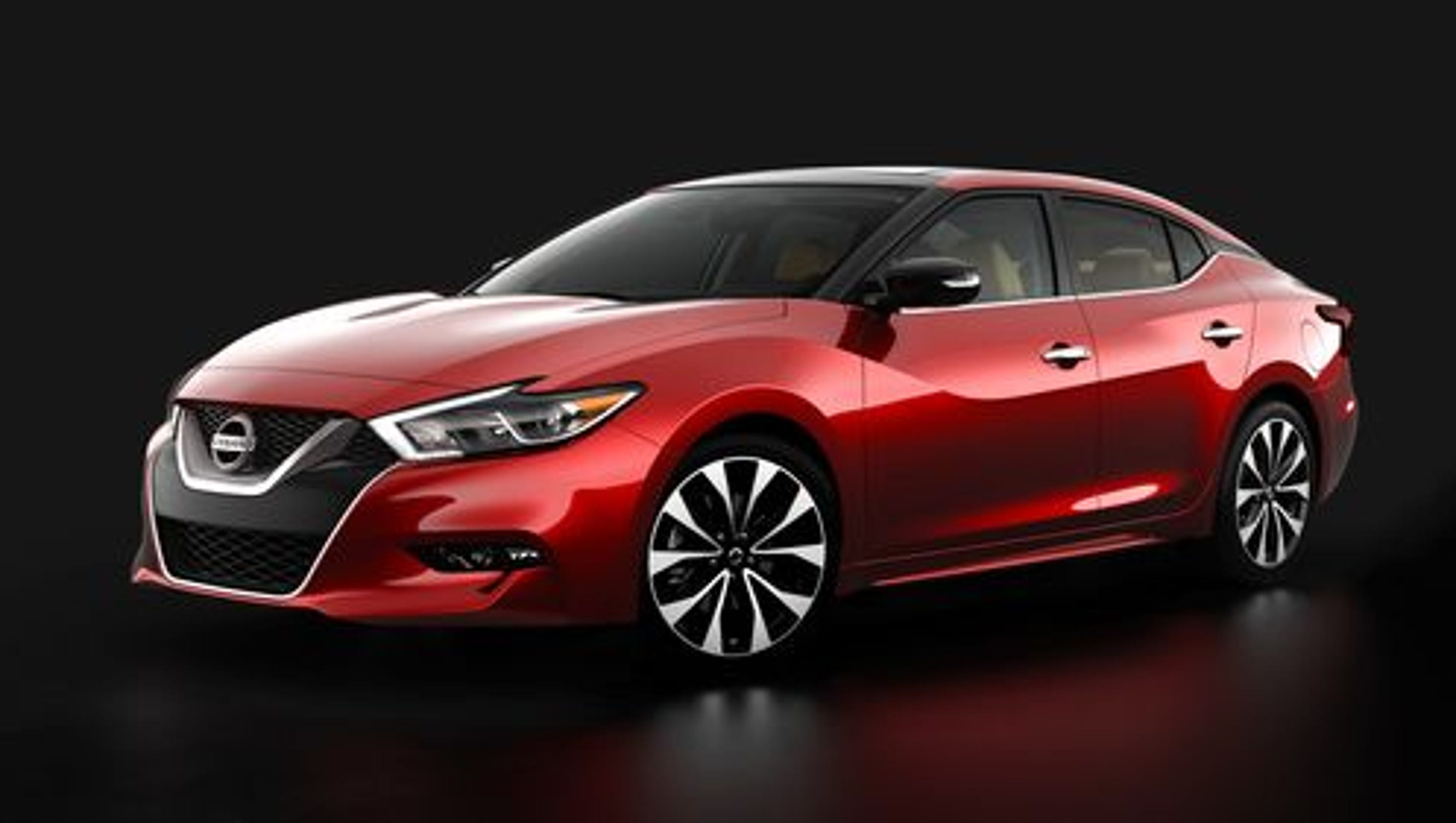 right nissan done red maxima sports sedan side maxim a driver dose