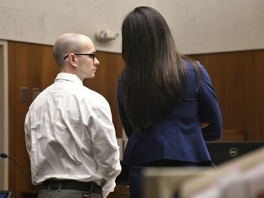 Aaron Rowe and his attorney JudyAnne Rogado speak before