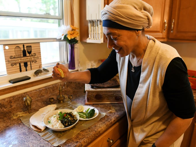 Summer Homayed squeezes lemon juice over the dish,