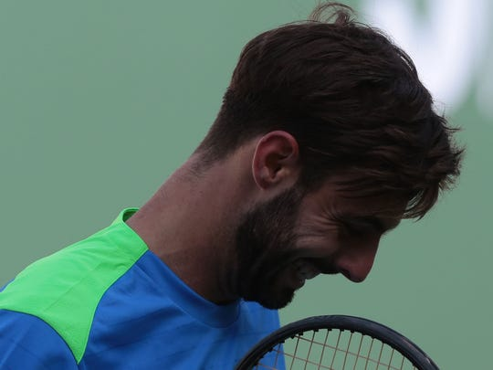 Marcel Granollers  of Spain is frustrated during his