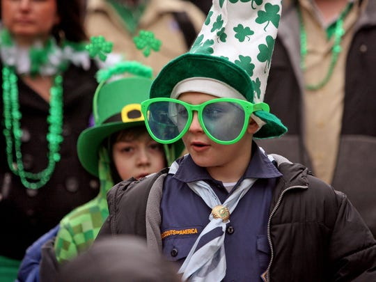 Cub Scouts don holiday garb as they march in the 2015 Somerville St. Patrick's Day Parade in 2015.