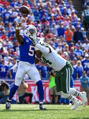 The Jets' Kony Ealy did not get penalized on this play when his hand hit Tyrod Taylor's facemask. Nor should he have been.