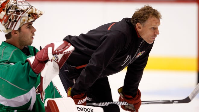 Sean Burke, the goal tending coach for the Arziona Coyotes, listens during practice.