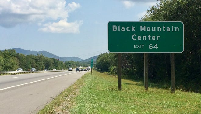 """A reader is curious about what """"center"""" this Interstate 40 sign refers to."""