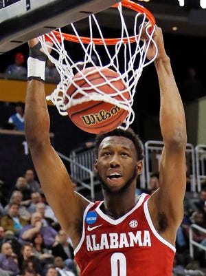 Alabama 's Donta Hall dunks the basketball during the first half of an NCAA men's college basketball tournament first-round game against Virginia Tech, in Pittsburgh, Thursday, March 15, 2018. (AP Photo/Gene J. Puskar)