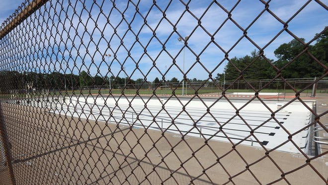 The gates are locked and the Dankwardt Park Pool is empty Tuesday in Burlington.