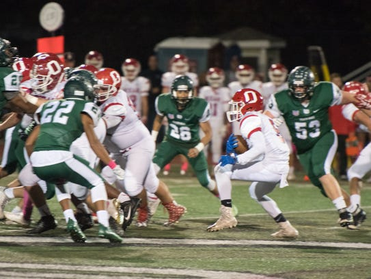 Ocean's Alex Bryant (5) carries the ball. Long Branch