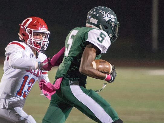 Ocean's Michael Kircher (13) chases down Kevin Porch