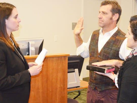 ErickDoyle is sworn in by NJDA Legal Specialist Lauren