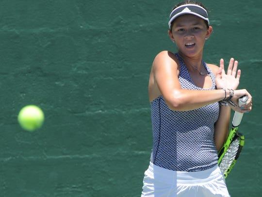San Antonio's Sydney Fitch returns a shot against Cedar