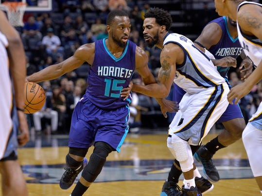Charlotte Hornets guard Kemba Walker (15) drives against Memphis Grizzlies guard Mike Conley in the first half of an NBA basketball game, Monday, Nov. 28, 2016, in Memphis, Tenn. (AP Photo/Brandon Dill)