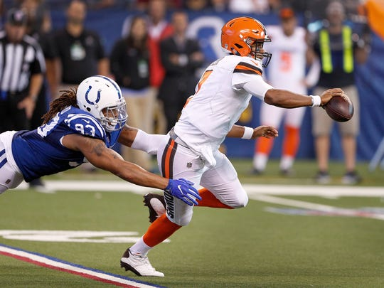 Cleveland Browns quarterback DeShone Kizer (7) runs away from Indianapolis Colts outside linebacker Jabaal Sheard (93) in the second half of their game at Lucas Oil Stadium Sunday, Sept. 24 2017. The Colts defeated the Browns 31-28.