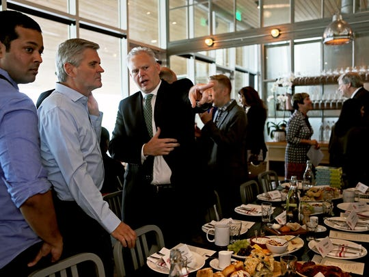 Billionaire investor Steve Case, second from left, talk with Richard Smith, son of FedEx founder Fred Smith, before breakfast at The Kitchen during a Rise of the Rest bus tour stop at Shelby Farms Park on May 8, 2018. Case is the co-founder of AOL. The tour was part of a national effort to shine a spotlight on trends shaping today's U.S. economy.