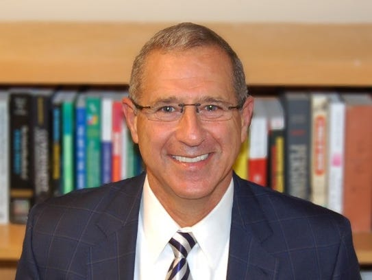 Michael Harris is a dean and professor in the school