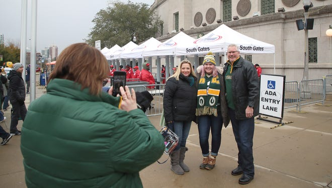 Erin Hein, Kassi Hein and Don Hein, Green Bay Packers fans from Appleton and Arizona, have their photo taken by Kathy Hein in front of Soldier Field before a Nov. 12 game between the Packers and the Chicago Bears.