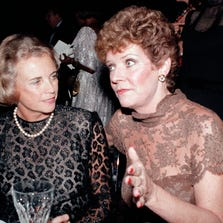 In this Oct. 3, 1984, file photo, U.S. Supreme Court Justice Sandra Day O'Connor, left, speaks with actress Polly Bergen at a National Women's Forum dinner in Washington. Bergen, an Emmy-winning actress and singer, died Saturday, Sept. 20, 2014, at her home in Southbury, Conn.,