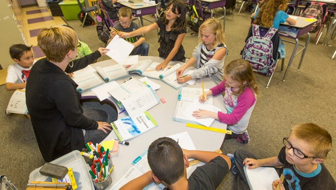 Third-graders work in Amber Moore's classroom at Four Peaks Elementary School in Apache Junction. The district next year  is  moving to a four-day school week in the face of state budget cuts.