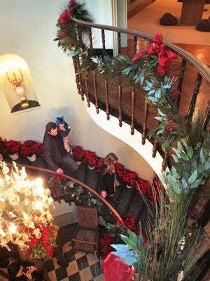 People tour the Lilly House, decorated for Christmas, in 2013.