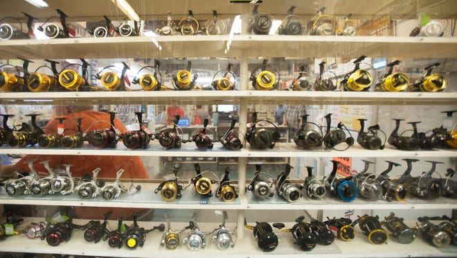 Reels on the shelf at Old Inlet Bait and Tackle.