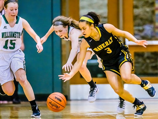 Jazlyn Wilcox ,3, of Waverly steals the ball from Kenzie
