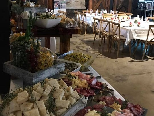 A table of cheese and charcuterie at The River Center.