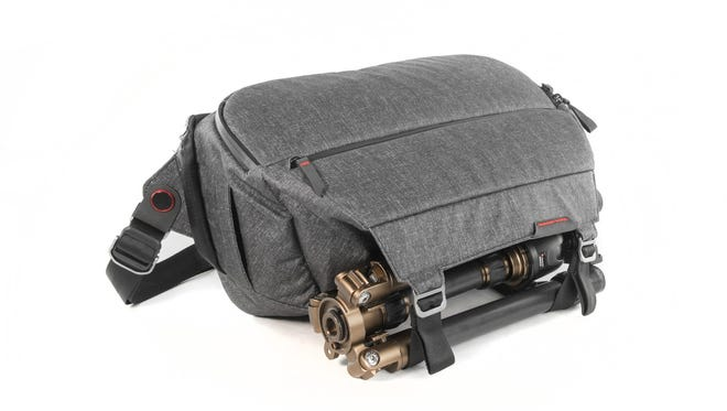Peak Design Everyday Sling bag's front straps can be used to secure a tripod.