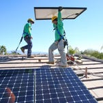 Rooftop solar is booming, despite political battles