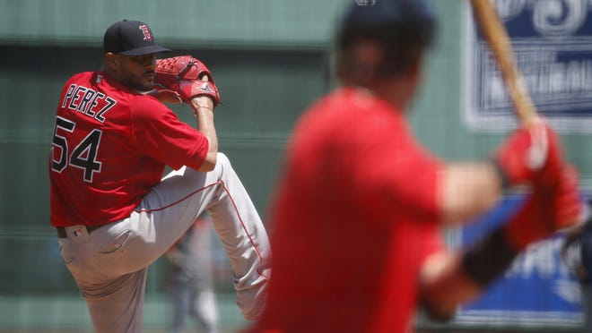 Red Sox pitcher Martin Perez, who started in an intrasquad scrimmage Thursday,  pitches during a practice July 5 at Fenway Park.