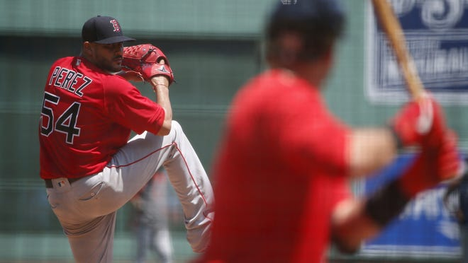 Red Sox left-handed pitcher Martin Perez fires a pitch during practice at Fenway Park, Sunday, July 5, 2020, in Boston.