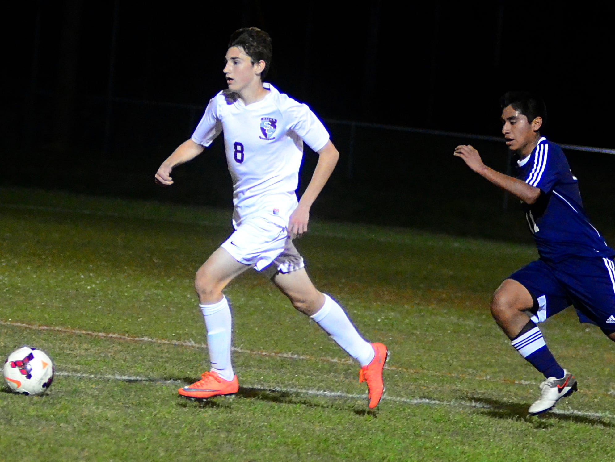 Station Camp High freshman Riley Indermuehle dribbles away from Cookeville's Eddie Gaspar during second-half action. Indermuehle scored a goal in the Bison's 3-0 victory.