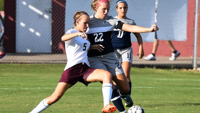 Henderson's Maddie Griggs battles with Reitz's Mallorie Stein as July Johnston looks on as the Henderson County Lady Colonels play the Reitz Panthers in a soccer matchup at Colonel Field Thursday, August 25, 2016.