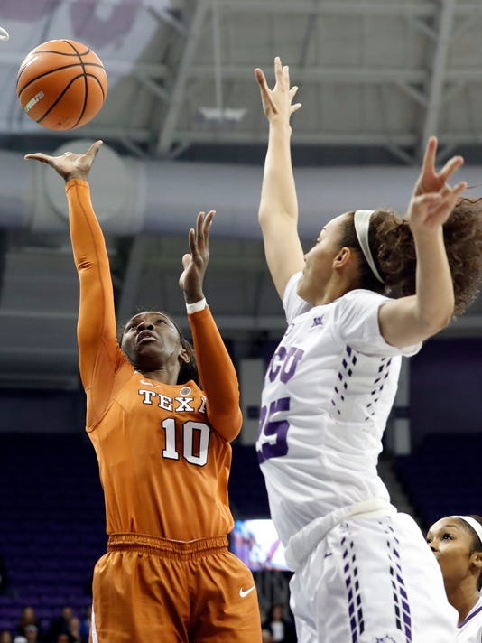 Texas guard Lashann Higgs (10) shoots as TCU guard Kianna Ray (25) defends during the first half of an NCAA college basketball game, Wednesday, Jan. 10, 2018, in Fort Worth, Texas. (AP Photo/Tony Gutierrez)