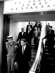 U.S. Attorney General Robert Kennedy, right, walks through the airport with local attorney and friend John J. Hooker after arriving in Nashville on June 29, 1962.
