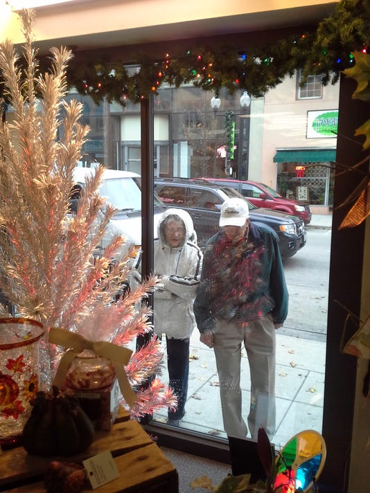 manitowoc aluminum christmas trees illuminate downtown stores for evergleams on eighth - Aluminum Christmas Tree Ebay
