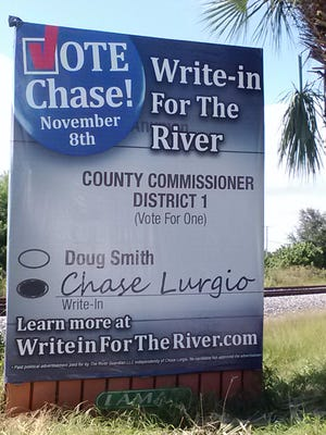 A billboard on State Road AIA south of Monterey Road in Stuart. An organization identifying itself as The River Guardian actively supported Chase Lurgio, a write-in candidate for Martin County Commission, District 1.