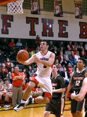 Travis Johnston drives for a layup during the fourth quarter of Rosecrans' 59-45 win against visiting Claymont on Friday night at Rogge Gymnasium. Johnston, a senior, had 11 points, 12 rebounds and eight assists.
