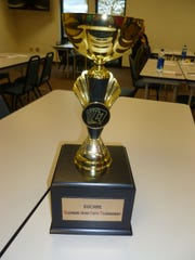 The Gleaners Interfaith Euchre Tournament Cup makes