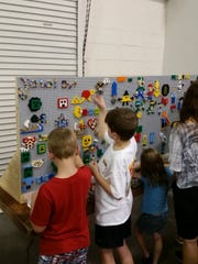 The graffiti wall at Brickworld invites kids to make their own artwork out of LEGOs.