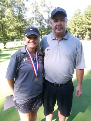 Izard County's Mikayla Kish, pictured with golf coach David Harmon, won her third straight Class 1A individual state championship on Tuesday at Tannenbaum Golf Course.