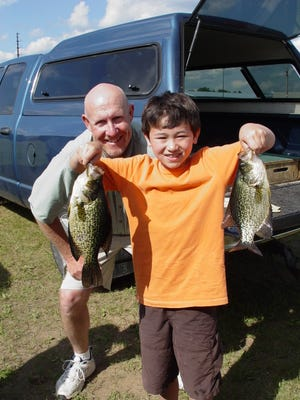 August Wang with his 14.5 inch crappie caught at the Guides/Kids Fishing Day on Thursday, July 10 in Eagle River.