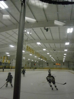 A bullet hole is visible in the glass panel mounted on the rink boards at the Waupun Community Center. The stray bullet pierced the wall on the south end of the building, traveling across the rink and breaking through the glass panel on the south end of the building.