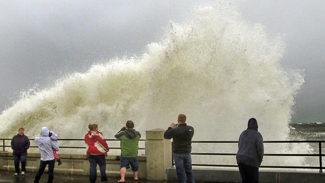 This Oct. 29, 2012, photo shows people watching waves crash in Hampton from the effects of Hurricane Sandy. The first phase of Hampton's master plan update will focus on coastal management.