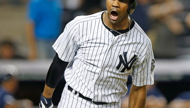 The Yankees'  Chris Young reacts after hitting a ninth-inning, walk-off, three-run home run to lift the Yankees to a 5-4 victory over the Tampa Bay Rays Thursday night at Yankee Stadium.